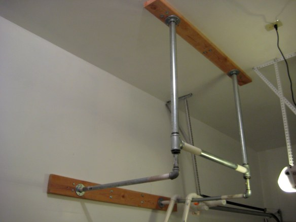 Completed pull up bar in garage gym